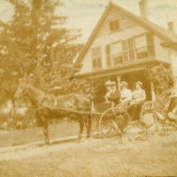 Photograph of Horse & Carriage with Passengers